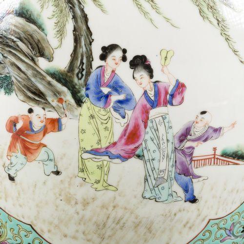 A set of (2) porcelain lidded jars with famille rose decoration, marked Guangxu,…