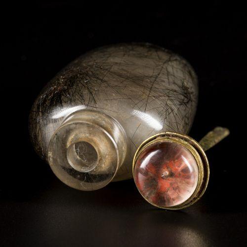A snuff bottle, rutile quartz with hair, China, 19th century. H. 8 cm. Estimatio…