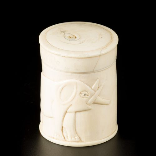 Two ivory carvings of a villagescene above a wokmans head, and a lidded pot deco…