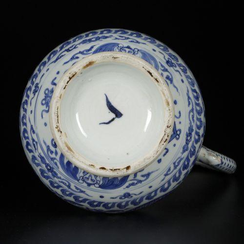 A porcelain blue white pouring jug with floral decorations and landscape decors …