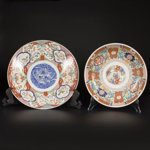 A lot comprised of (2) porcelain chargers with floral decorations, Japan, late 1…
