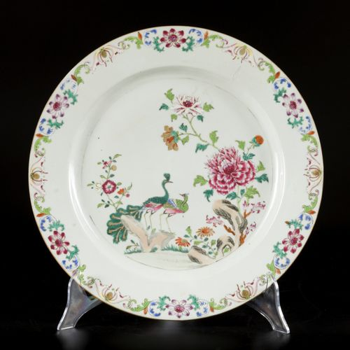 A porcelain famille rose charger decorated with two peacocks, China, Qianglong. …