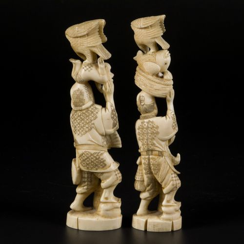 A set of (2) ivory okimonos in the shape of Japanese gentleman with animals, Jap…