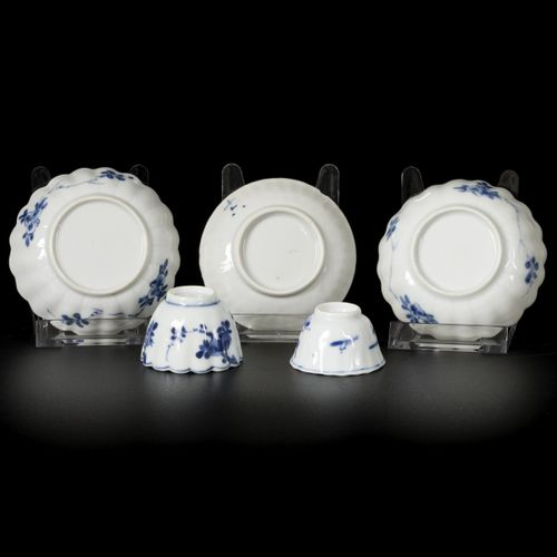 A lot comprised of (3) porcelain ribbed dishes and two cups with floral decorati…