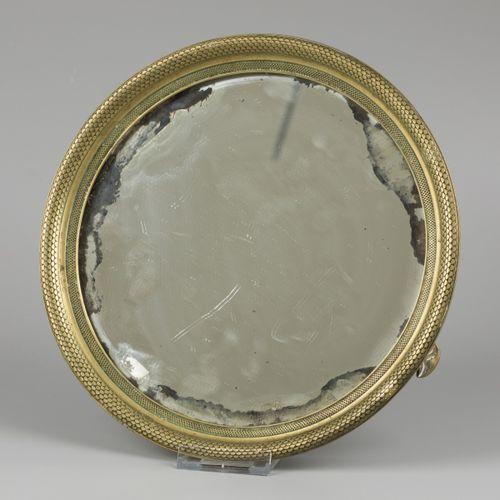 A bronze cabaret with mirror glass, early 19th century. Avec un miroir rond de t…