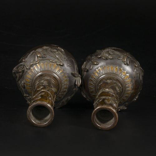 A set of (2) bronze pipe vases with decoration of flowers and birds, Japan, late…