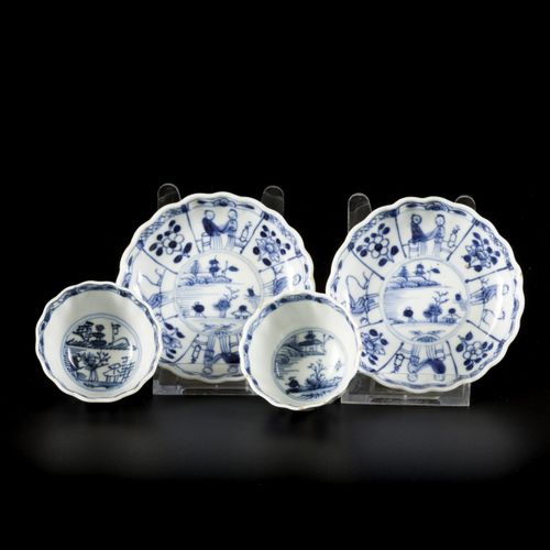 A set of (2) cups and saucers with a decoration of figures in compartments, Chin…