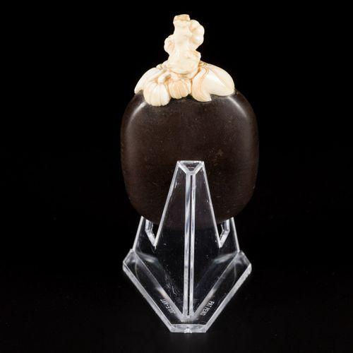 A walnut snuff bottle with bone fittings, China, 19th century. H. 8 cm. Estimati…