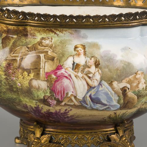 An earthenware jardiniere with bronze frame decorated with a pastoral scene, mar…