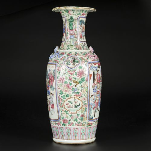 A porcelain baluster vase with floral decorations and in the centre a scene with…