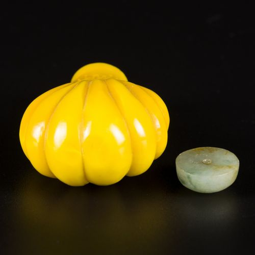 An imperial yellow glass snuff bottle, fruit shaped, China, 19th century. H. 6 c…
