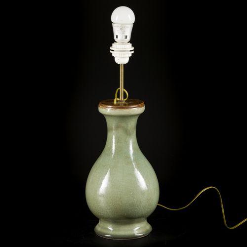 A celadon vase converted into a lamp base, China, 19th century. Dim.34 x 18 cm.估…