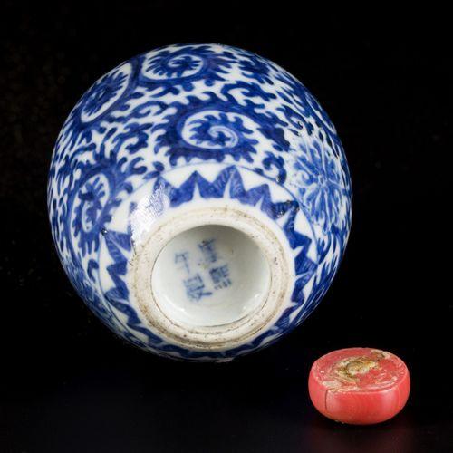 A porcelain snuff bottle with landscape decor, China, 19th century. H. 8 cm. Est…