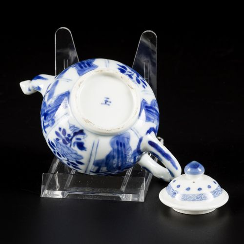 """A porcelain teapot with decoration of flowers and Lingzi, marked Yu """"jade"""", Chin…"""