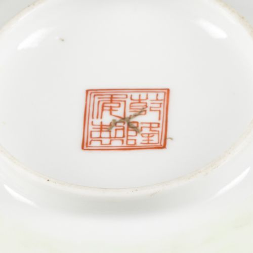 A set of (2) porcelain bowls with decoration of pupils in a garden, marked Qiang…