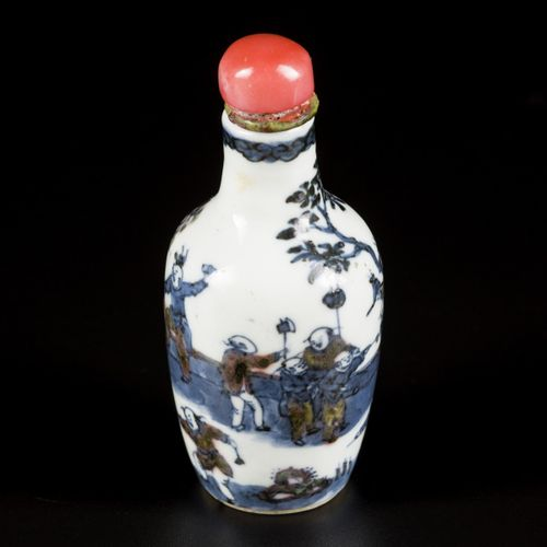 A porcelain iron red snuff bottle decorated with playing kids, China, 19th centu…