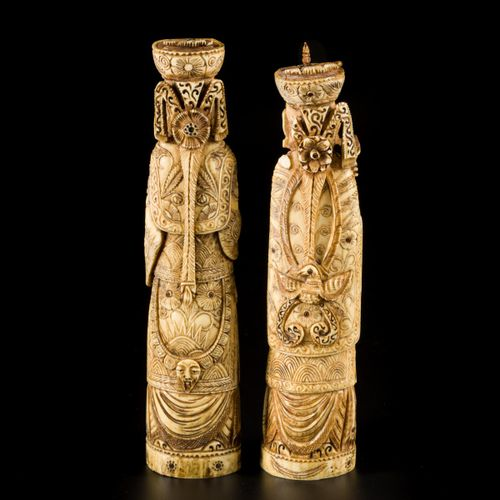 A lot comprising (2) ivory carvings of a wise man and a noble lady, China ca. 19…