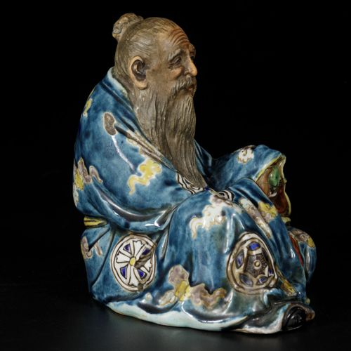 A sitting porcelain philosopher with a peach in his hand, China, 19/20th century…