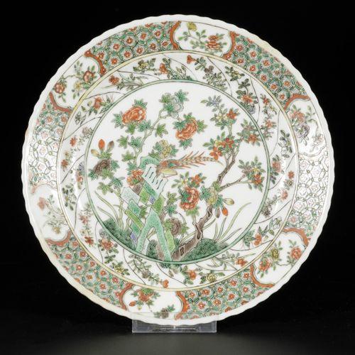 A porcelain plate with famille verte decor, China, 19th century. Diam. 22,5 cm. …