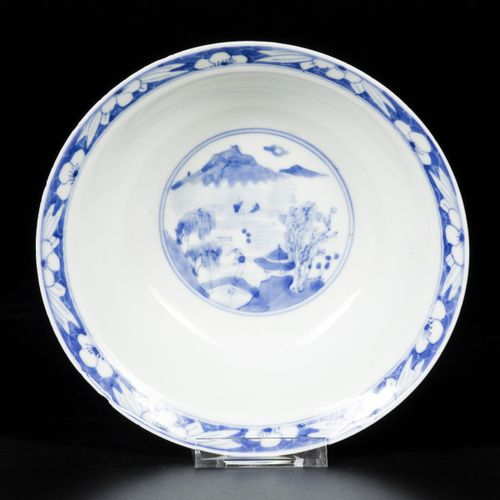 A porcelain bowl with figures decorations on the exterior and river landscape on…