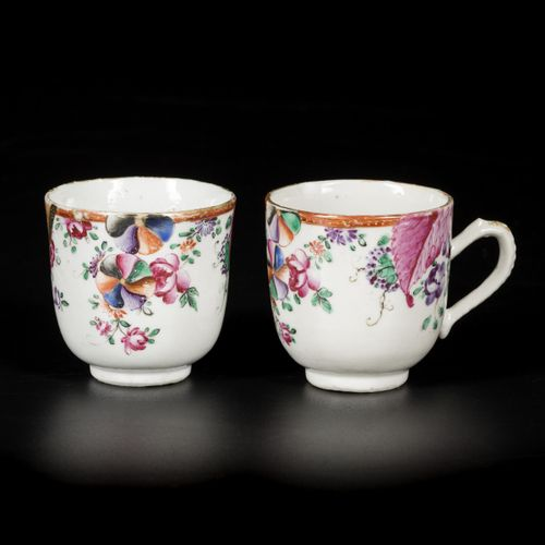 A set of (2) porcelain famille rose cups with handle, with floral Tobacco decora…