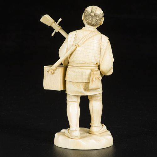 An ivory okimono of a music playing elderly gentleman, Japan, late 19th century.…