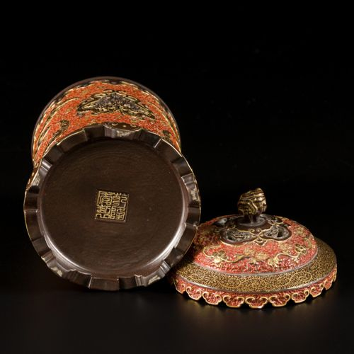 A porcelain incense burner with brown and brick red fond decorated with clouds a…