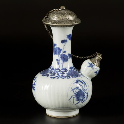 A porcelain kendi with white metal spout and lid, China, 18th century. Dim.22 x …