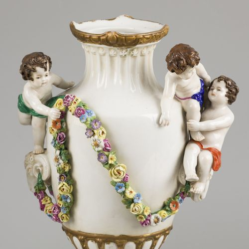 A set of (2) porcelain vases decorated with flowers, ram heads and children, Sit…