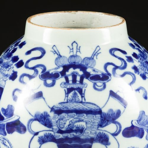 A porcelain vase with celadon fond decorated with antiques. China, 19th century.…