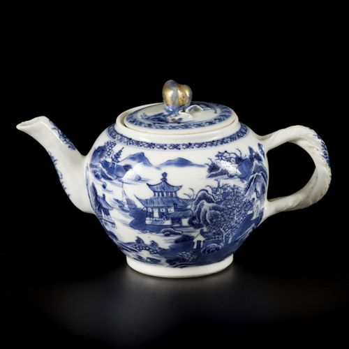 A porcelain teapot with river landscape and pagoda decor, with fruit shaped knob…