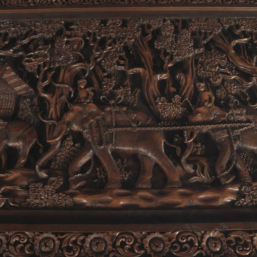 A richly ornamented diner table with Balinese carvings, Indonesia, 2nd half of t…