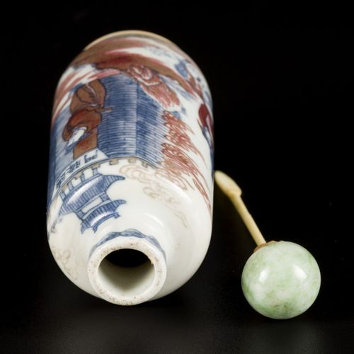 A porcelain iron red snuff bottle decorated with warriors, China, 19th century. …