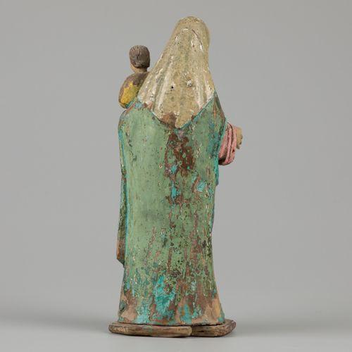 A polychrome sculpture of a Madonna and kind, Phillipines 19th C. H. 32 cm. Esti…