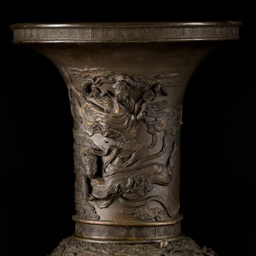 A large bronze vase decorated with chrysanthemums, (crane) birds and blossom bra…