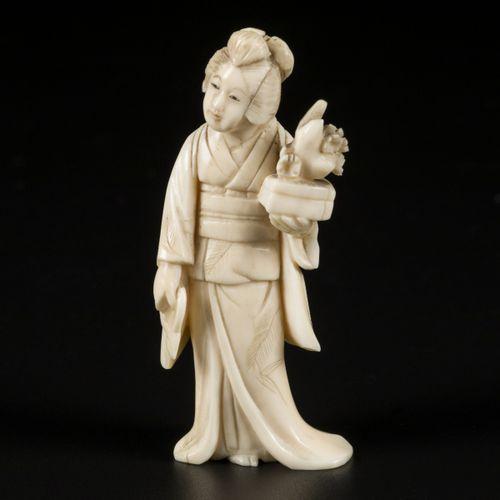 An ivory okimono of a Japanese lady wih a bonsai tree. Japan, late Meiji period.…