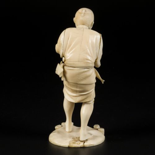 An ivory sculpture in the shape of a fisherman, Japan, late Meji period. Estimat…