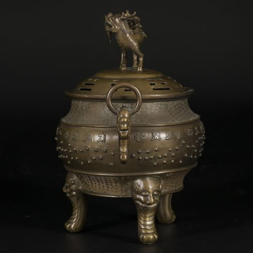 A bronze incense burner decorated with Chinese characters, China, 19th century. …