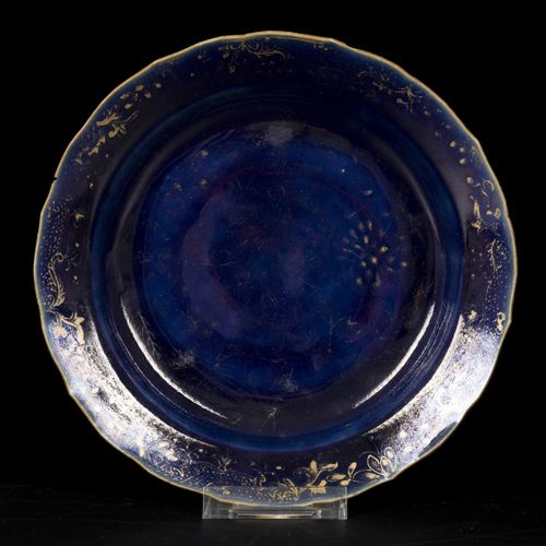 A lot comprised of (8) powder blue porcelain plates with residual of gold decora…