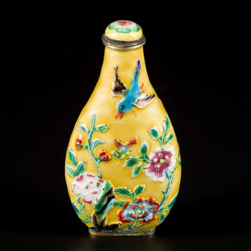 An enamel snuff bottle decorated with flowers and birds, China, 19th century. H.…