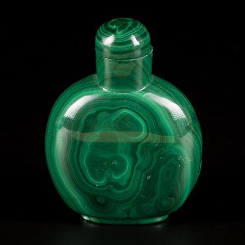 A malachite snuff bottle decorated with Buddha, China, 1st half 20th century. H.…