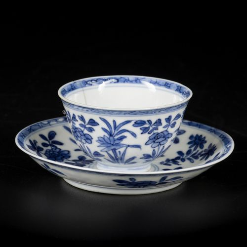 A porcelain cup and saucer with floral decorations and 6 character mark, China, …