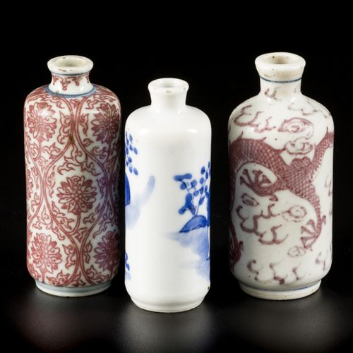 A lot comprised of (3) porcelain snuff bottles a.W. Two with 'iron red' decor, C…