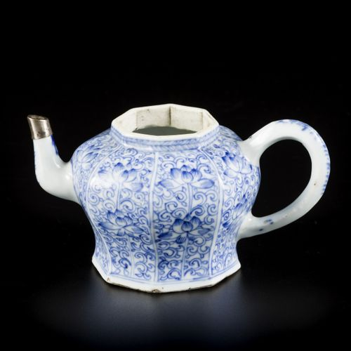 A porcelain teapot with floral decoration in compartments, China, Kangxi. Dim. 8…