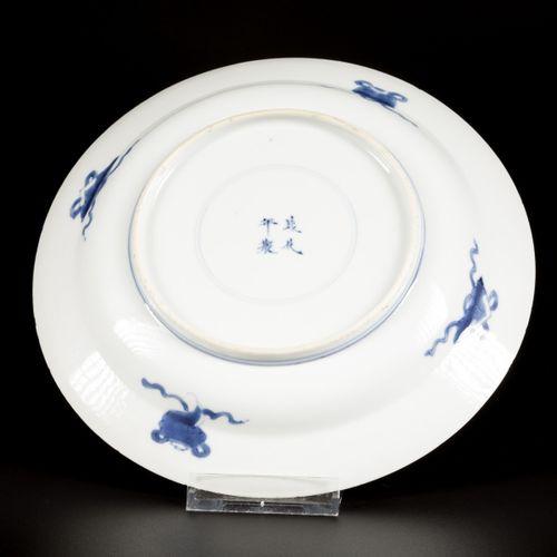 A porcelain plate with landscape decor, marked Chenghua, China, Kangxi. Diam. 20…