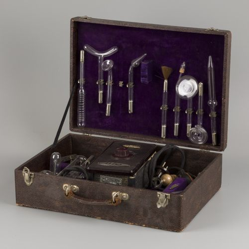 A 'Helios' set medical instruments for ultraviolet light therapy in case, German…