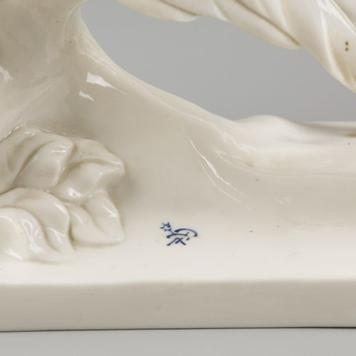 A porcelain sculpture group of a pair of gold pheasants, marked Passau, Germany,…