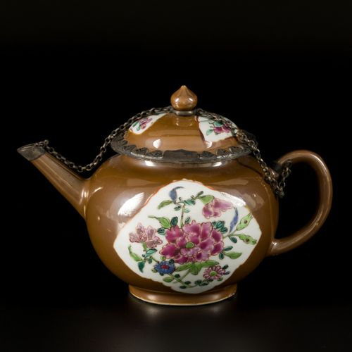 A porcelain teapot with capucine fond and floral decoration in the center, China…