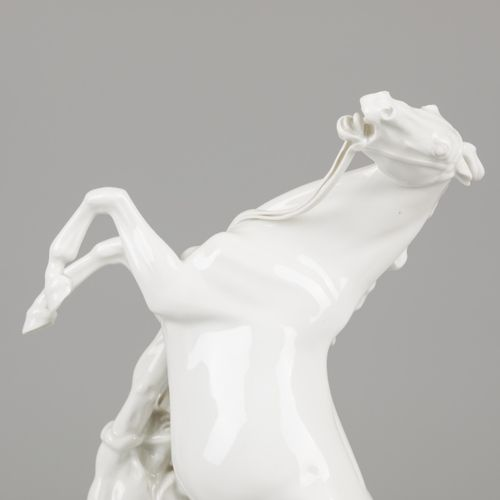 A porcelain equestrian group of a stallion and groom, Erich Oehme (1898 1970) in…