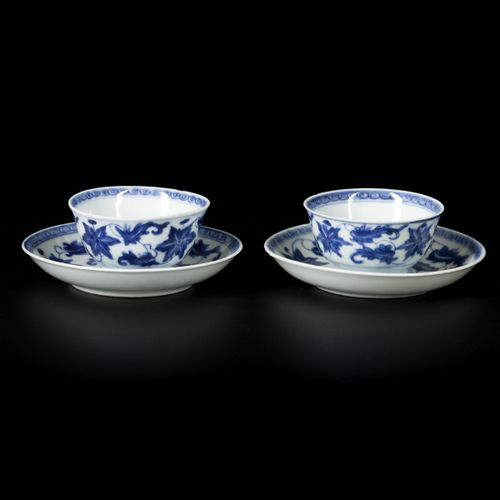 A set of (2) porcelain cups and saucers with floral decorations, China, Kangxi/Y…